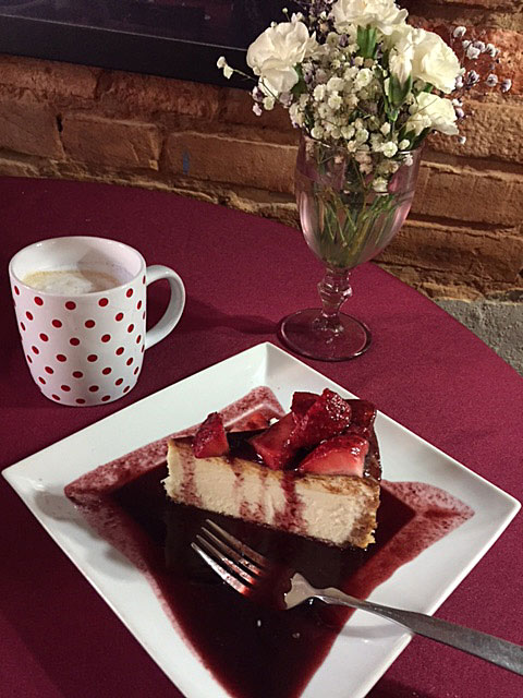 White Chocolate Cheesecake with strawberry/blueberry sauce at Austin Street Bistro