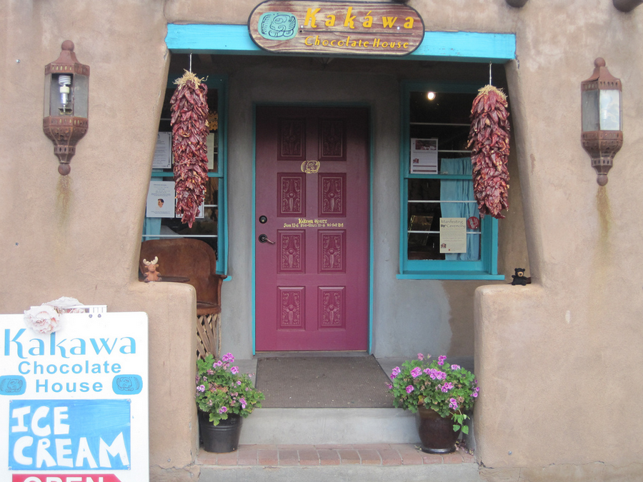 The facade of Kakawa Chocolate house.  Love the pink front door.
